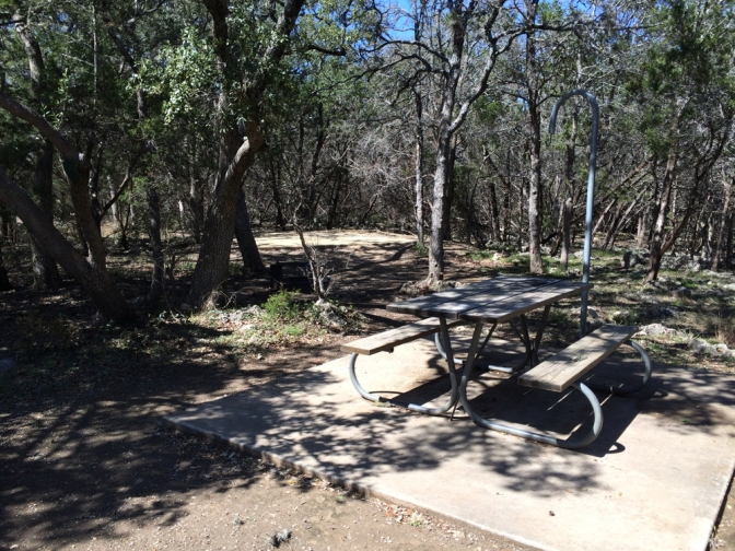 Picnic table and tent pad at site