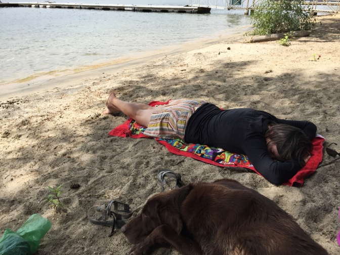 Kathy and dog napping at the beach