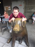 Jason riding the pig