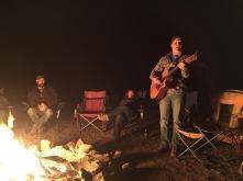 Clark entertains around the fire
