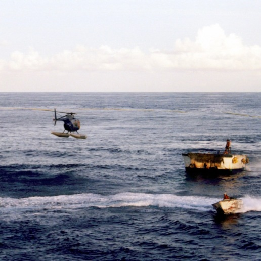 Another StarKist ship's helicopter helping out the Auro's skiff and speedboat making noise to keep the tuna from escaping out the opening in the net before it gets closed