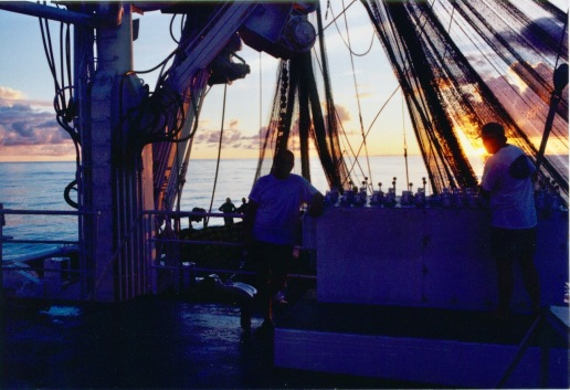 Me (left) posing at sunset as Gary (navigator - right) is bringing the net in