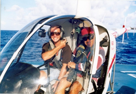 """Jean """"JC"""" (pilot) and Oscar (mastman, but also was the helicopter's fish spotter)"""