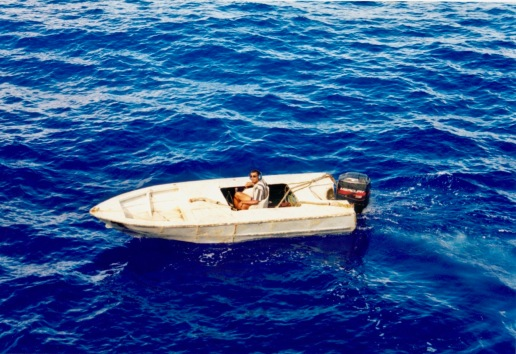 Tino (assistant skiffman) operating one of the speedboats